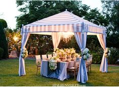 Great Gatsby Wedding Inspiration using lavender as the main color - love this tent decorated with large white blooms and a chandelier