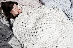 "Guaranteed to keep you cozy on your Living Cube, this über cuddly blanket has 3"" stitches Ohhio blanket by Anna Marienko"