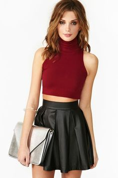 Rebel Crop Turtleneck. Love the leather skater skirt and silver clutch <3