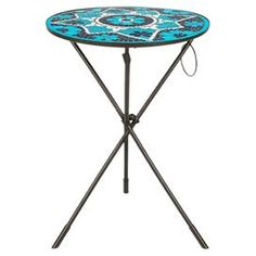 "Perfect for displaying a potted plant in your entryway or resting a tray of cocktails in the living room, this beautiful side table showcases a cinched iron base and mosaic-inspired top.   Product: Side tableConstruction Material: Iron and tileColor: BlueFeatures:  Cinched baseMade in India Dimensions: 23"" H x 15.7"" Diameter"