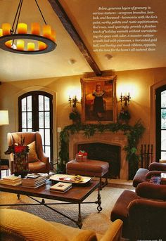 Living room with Tudor arch fireplace mantel decorated for Christmas -- Victoria magazine