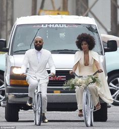 Breaking with tradition: Solange and her future husband Alan Ferguson were spotted riding bicycles to their nuptials
