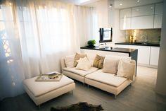 Stunning black & white interior with a Quick-Step Largo 'Long Island Oak Light' (LPU1660) laminate floor on the ground. www.quick-step.com