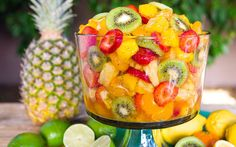 The Best Ever Tropical Fruit Salad is the only recipe you& ever need. The Best Ever Tropical Fruit Salad is the only recipe you& ever need. My entire picky family devoured this fruit salad. The dressing is truly ma. Delicious Desserts, Yummy Food, Tasty, Tropical Fruit Salad, Hawaiian Fruit Salad, Tropical Desserts, Pineapple Fruit, Tropical Party, Healthy Snacks