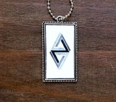 Penrose 3D triangle pendant / impossible triangle / geometric jewelry / geometric necklace by prettyinc2. Explore more products on http://prettyinc2.etsy.com