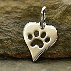 Adorned with a cute cut out paw print, this heart charm shows our love for the fuzzy friends in our lives. We know many of you have special pets, so now you can celebrate them with this adorable paw print charm!See more charms celebrating furry friends!Our silver plated bronze is 40 micro inches of fine silver plated over bronze with a thin layer of nickel in between to prevent migration of the two metals, resulting in a very reliable product.  Our silver plated bronze is protected with an anti-tarnish finish.  Find more details and care instructions in FAQs. Cast and hand finished in Thailand.