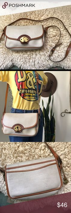 80's Dooney&Bourque crossbody Beautiful 80's cross body original dooney. The purse is off white with the gold  signature hardware and tan leather trimmings. Has some pen marks inside and is a little dirty from the outside . In vintage used condition . Dooney & Bourke Bags Crossbody Bags