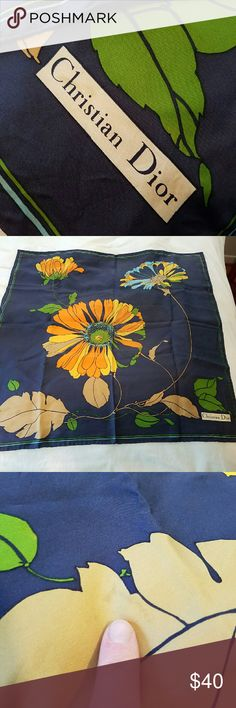 Vintage Christian Dior floral silk scarf Gorgeous navy and orange-gold floral print. Classic and classy 70s style vintage. Some faint darker (water?) spots - they are difficult to see unless you are looking for them. I have not attempted to dry clean it. Measures 30x30 inch. Christian Dior Accessories Scarves & Wraps