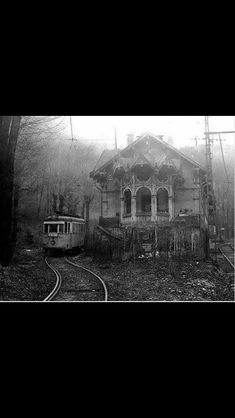Abandoned European railway - an old multiple unit train sits in the lonely siding next to a ramshackle signal box