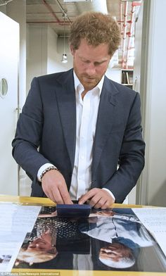 Harry was also able to examine the medal presented to Mandela when he won the Nobel Peace ...