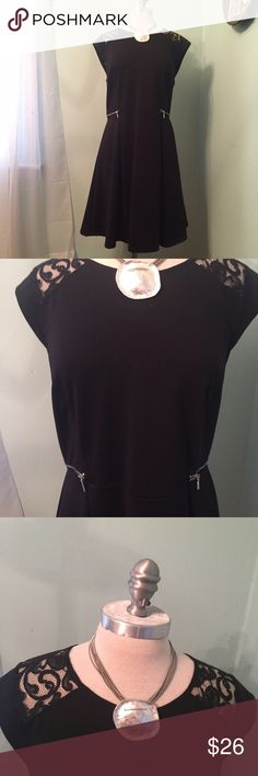 NWT Adorable Fit and flare dress with lace details NEW Adorable black Fit and flare dress, has lace detailing at shoulders visible from both front and back, fun zipper details accentuate the waist, this dress is so very flattering on, the mannequin doesn't do it justice. Bust: 19.5 in (armpit to armpit when flat) waist 18in (side to side on waist seam when flat) Material is 74% polyester 20% rayon 6% spandex so it has a good amount of stretch and give. This dress in NEW with tags. I…