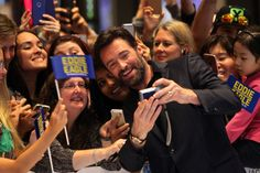 Hugh Jackman poses for selfies with fans as he arrives on the red carpet ahead of the Eddie The Eagle screening at Village Cinemas Crown on March 29, 2016 in Melbourne, Australia.