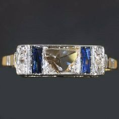 Art Deco ring with sapphires and rose cut diamonds in two colors 18K gold