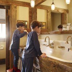 reclaimed wood trim around mirror, trough sink!!