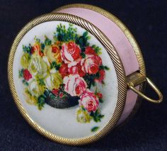 Antique Tiny Tape Measure Sewing Notion Made in Germany Pink Enamel Retractible Reverse Painted Red Roses Beauitful Jem Vintage Chic.  via Etsy.