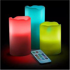 """Color-Change LED Candle Set with Remote. Especially for those that can't burn candles in the house cos of pets and crazy Children etc. :-) Check out these LED Candle imitators that """"burn"""" in 12 different colors from Flameless Candles, Pillar Candles, Easy Gifts, Cool Gifts, Gadget Gifts, Color Changing Led, Candle Set, Cool Gadgets, Color Change"""