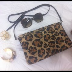 Brand New! Coach Leopard Handbag Brand New with Tags! Beautiful Coach Leopard Shoulder or Crossbody Handbag retail $180 tax no trades please. Gucci Sunglasses shown are also for sale in my closet! Coach Bags