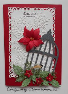 "Selmas Stamping Corner: Seasons Greetings - Spellbinders Dies: ""Romantic Rectangles"" and ""Moroccan Accents"" Sizzix Embossing Folders: ""Winter Botanicals"" and ""Woodgrain"" Cheery Lynn Dies: ""Holly Leaves"" and ""Wreath Strip"" branches  Poppy Stamps Die: ""Blooming Poinsettia""  Tim Holtz Die: ""Caged Bird""  Impression Obsession (C8589) bird stamp set"