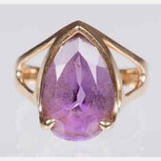 A 14kt. Yellow Gold and Amethyst Ring. Total weight: 3.1 dwt. Ring size: 6 1/2.