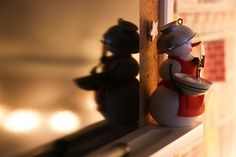 baking snowwoman aglow with twinkle lights