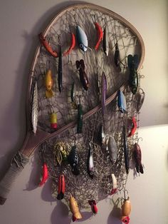 Antique fishing lures displayed on vintage net - Antique fishing lures displaye. - Antique fishing lures displayed on vintage net – Antique fishing lures displayed on vintage net - Fishing Room Decor, Fishing Nursery, Fishing Lure Decor, Boys Fishing Bedroom, Rustic Fishing Decor, Fishing Decorations, Fishing Crafts, Fish Net Decor, Fish Bathroom