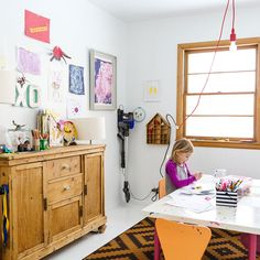 hanging bulb light   A Cheery Midwestern Home Dedicated to Keeping Spirits High | Design*Sponge