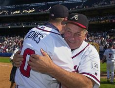 Atlanta Braves manager Bobby Cox hugs Chipper Jones #10 ~ its gonna be a different game from now on
