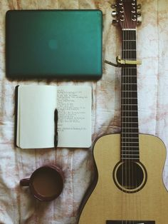 notebook + guitar + pen + coffee + capo + bed + apple laptop = my life