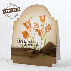 Watercolor Newspaper Tulips card by Shari Carroll for Hero Arts.  Features Tim Holtz Cabinet Card die.