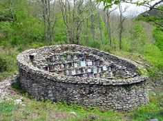 photo of an alveriza (known as cortines in Asturias). These old constructions were built to protect beehives from bears. Note, the hives were positioned together to capture the maximum amount of sunlight.