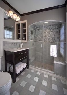 Arched walkin shower doors in a bathroom #design #perfection