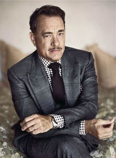 Tom Hanks ~56 years old and still sometimes has the mentality of a five year old. what a cutie.