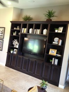 Built-in entertainment centers are not only for housing TVs. Optimal storage in cabinets below.