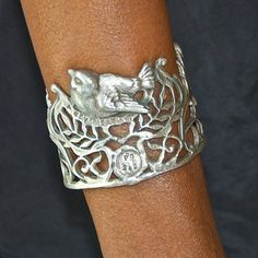Love illustrative jewelery.  The Bird Cuff by Perry Gargano