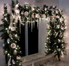 I have done this before on a mirror..looks beautiful. Garland draped over the bathroom mirror.