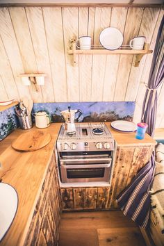 Priscilla's exquisite kitchen is made from reclaimed materials - the cabinets are made from the old flooring of a welsh chapel and the backsplash comes from an old oil tank. The wall cladding is sustainably harvested chestnut. And without any compromise on functionality - she has an oven, grill and hobs as well as a 2-way fridge. You can hire her yourself! See more pictures as well as prices at www.quirkycampers.co.uk/campervans/priscilla. Camper van hire - Bristol - Priscilla - Quirky…