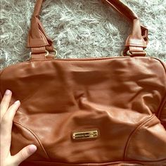Brown Steve Madden Purse Brown, double zipper, Steve Madden Shoulder purse. Included a picture of some damage in the corner. Used but still in good condition Steve Madden Bags Shoulder Bags