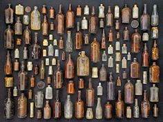 Antique glass bottles, part of my latest blog post, from Things Organized Neatly! See more at www.MyPaisleyWorld.blogspot.com