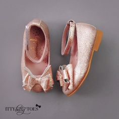 Baby girls rose gold leather 'Alba' shoes by Gjergjani Kids. These adorable dressy shoes have  rose gold leather velcro ankle strap and bow on the top. They are