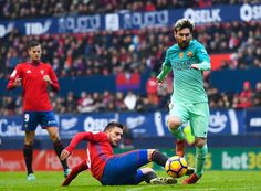 Lionel Messi of FC Barcelona competes for the ball with Roberto Torres of CA Osasuna during the La Liga match between CA Osasuna and FC Barcelona at Sadar stadium on December 10, 2016 in Pamplona, Spain.