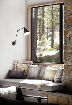 A cozy window seat, perfect for reading. and some stone walls. nicchia per leggere vicino alla finestra, fra muri di pietra