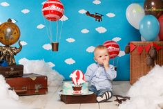 First  cake smash smashcake cakesmash ideas boy 1  year balloons flags decor rafinad  red blue clouds sky  smile face happy happiness studio air airplane plane pilot  aviator theme birthday traveller travelling bucket 80 days around the world theme