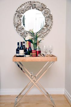 Lacquer Tray + Butler Tray Stand from west elm via @Apartment Therapy