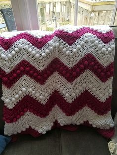 This crochet project features a series of cross stitches and bobbles, or X's & O's, so that is how this became the Hugs & Kisses Baby Blanket.
