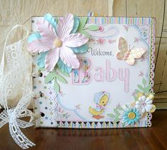 Two Crazy Crafters: Vintage Baby Mini Album. Great link, lots of pics of inside.
