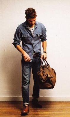 Dark rinse denim and rugged duffel bag.