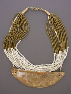 Necklace | Anna Holland.  Fifteen strands of brass heishi and white glass beads from Africa hold a beautiful  antique South Pacific gold lip mother-of-pearl pendant