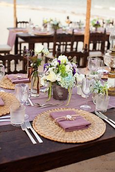 pretty outdoor tablescapes right on the sand  Photography by http://elizabethmedina.com, Event Design and Planning by http://amberevents.com, Floral Design by http://planner1events.com