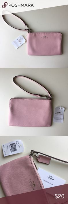 NWT Coach Pink Zip Wallet Good Condition New with tags. Smoke free home.  Very good condition except for the back of the wallet where it is stained a bit (as seen in pictures). Has authenticity cards in it. Has strap for wrist which can be taken off if just wanted to be used for a wallet. Pockets inside the wallet. Spacious enough for phone and credit cards. Coach Bags Wallets