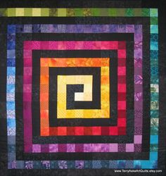 Beautiful use of tonal qualities to create a movement in the quilt.